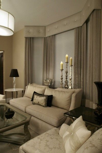 Elegant example off full length drapery behind furniture - Living room bay window treatments ...