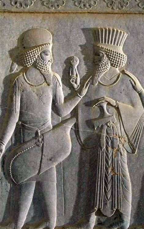 L – R: Ancient Achaemenian Median and Persian Soldiers Imperial Iranian Achaemenian Median Archer (Left) salutes the Persian Officer (Right) Hand on the shoulder means our allegiances and loyalty is with you. This was how warriors shown loyalty to their commanding officers.