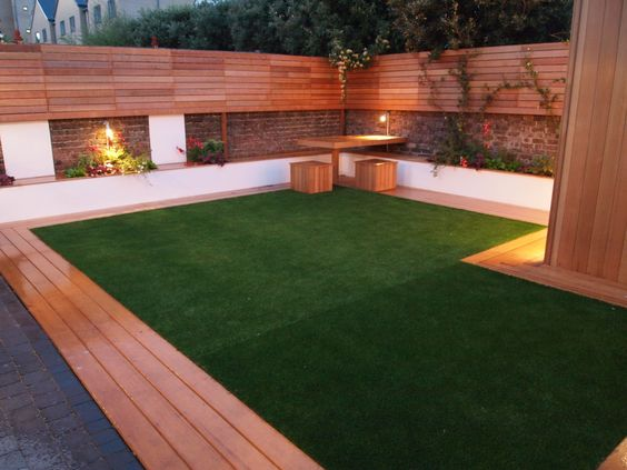 Artificial grass and decking look great with good garden for Garden decking and grass