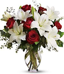 Red roses and white lilies in a vase - Buying Flowers for Valentine's Day - Holly Day