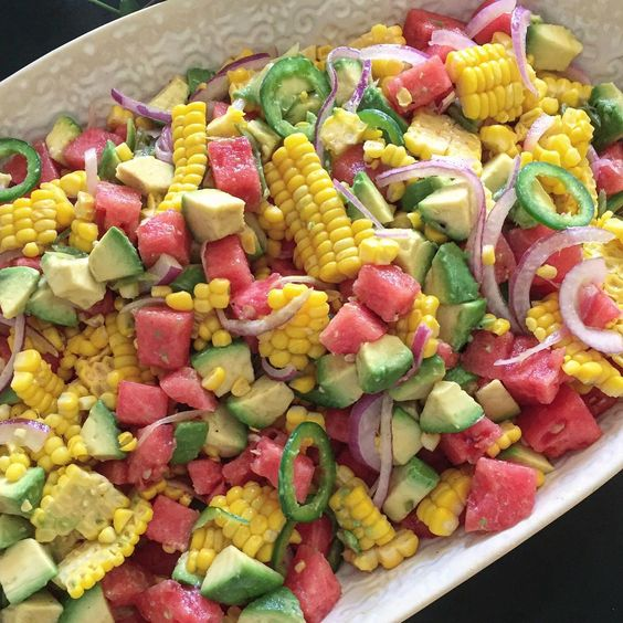 Some of you asked about the summer salad, which was definitely the hit of the party! I adore @snoopnattynat's recipes and was inspired by a recent post.  Fresh corn, watermelon, red onion, jalapeño, avocado, and mint, which I dressed with her Jalapeño Vinegrette. Whisk the following together and season with salt and pepper.  1/3 cup fresh lime juice 1/4 cup olive oil 1 scallion thinly sliced 1 jalapeno thinly sliced 1 small shallot thinly sliced