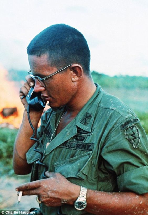 An officer from the 25th Infantry Divisionis given orders on a field telephone.