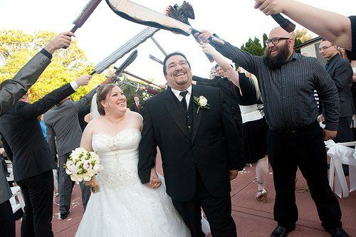 Gamer nerd wedding! Lightsabers, swords, staves, ect