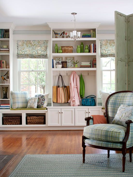 Kitchen cabinets create a functional mudroom near the front door. I LOVE this!
