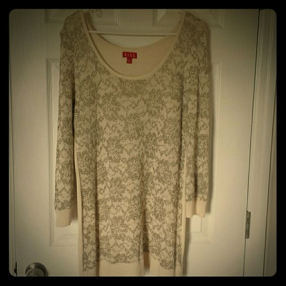 Super cute sweater This is a light sweater with gold thread accent on the front and sleeves only.  The back is all off white.  Sure cute with leggings and boots.  This sweater is very long,  almost tunic style. Elle Sweaters