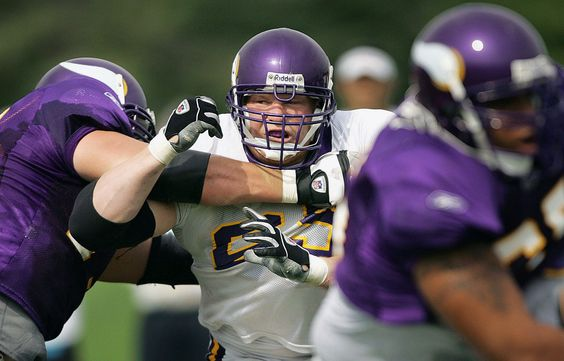 Pro wrestler Brock Lesnar fights through the offensive line in a morning drill…