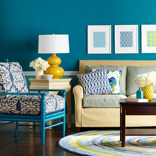 Bold teal walls provide a striking backdrop for an array of bright colors, patterns, and textures in this living area. The walls help to anchor the room, providing opportunity to incorporate an eclectic mix of furnishings, accessories, and textiles.