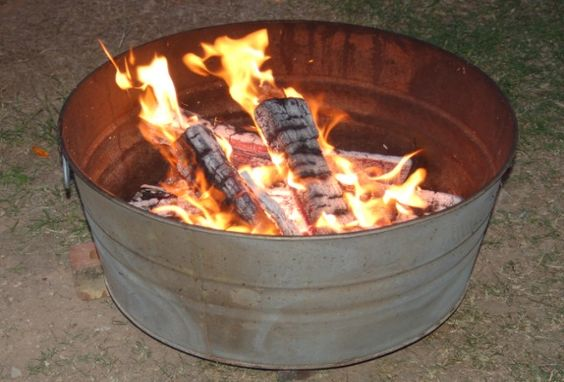 Cheap fire pit idea!! These tubs are cheap at the farm store - add a layer of sand in the bottom and around the outside for safety.  If you wanted a lid to keep the water out you could buy a tub the same size as a metal trash can lid.  You could also be able to use a grill on the top to cook on - but I'm not sure how the galvanization would affect any food cooked on it.
