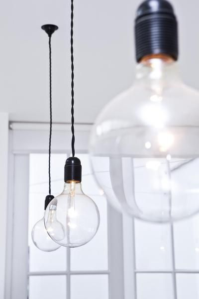 Make your own lights. We got the material:   http://www.byggfabriken.com/sortiment/belysning/kabel-och-tillbehor/info/produkter/724-102-svart-tvinnad-2-ledare/