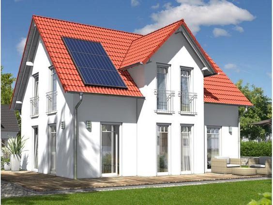 fehér színű családi ház piros tetővel