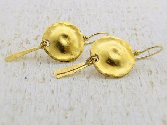 One of a kind , handmade 24k solid gold earrings with hammered gold dome and two dangle long leaves.    The back of the earrings is made of 9k solid gold.