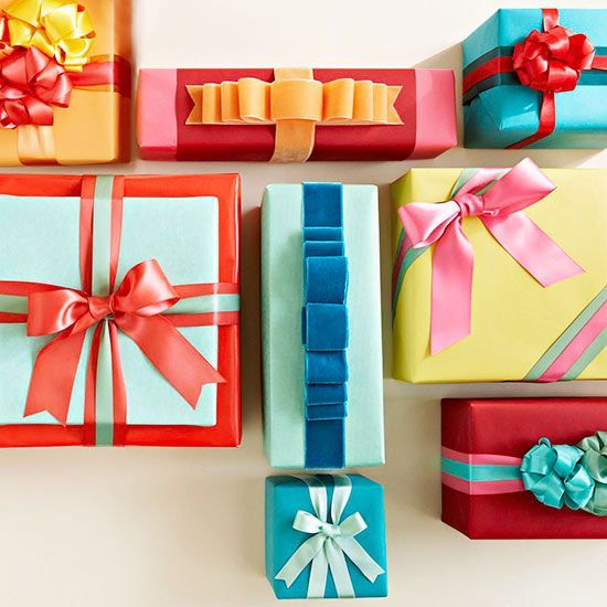 """Wow. Learn how to create really unique gift wrapping ideas using ribbons and bows, that will make your presents look too good to open! These ideas would be great to use for Christmas decorations as well - just wrap some """"presents"""" and use them as table decorations."""