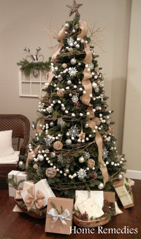 Might try the burlap ribbon this way & do the twine around like this tree. Cotton ball garland is cute, but looks time consuming!: