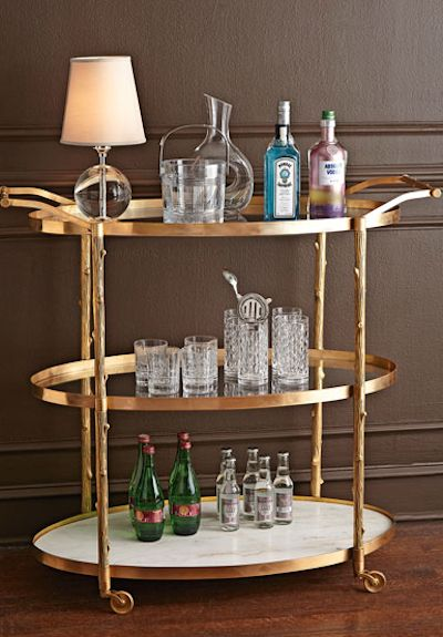 sleek brass rolling bar cart