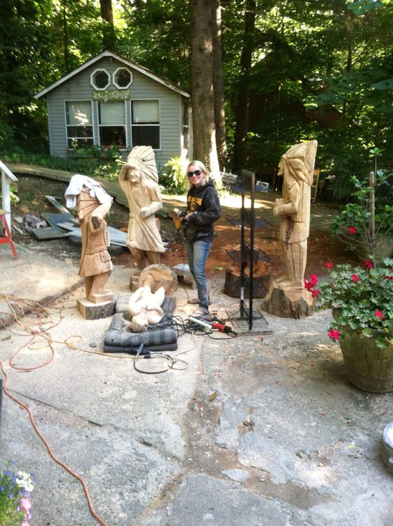 Julie carving Cigar store indian statues from Fall Creek Gallery 317-493-8583