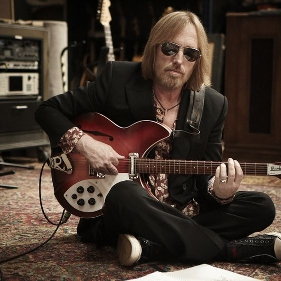 Tom Petty  ONE OF HIS ROADIES LIVED NEXT DOOR [when he was in town]