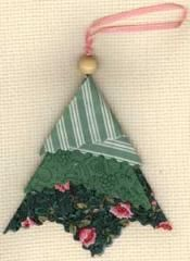 Fabric Folded Tree Ornament | This cute  little tree ornament is another no-brainer! If you're looking for a quick, no-sew ornament to make in just a few minutes... this is it! Use one, two, or three coordinating fabrics to make a whole bunch of these cuties!: