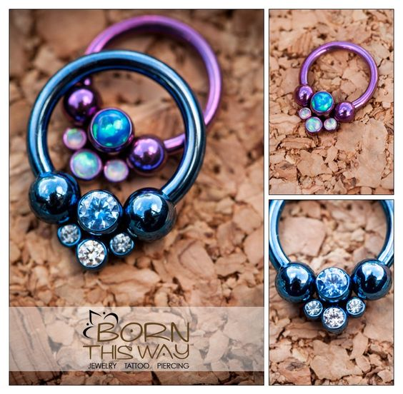 "These beautiful circular barbells are made from internally threaded F-136 titanium. They feature a removable gem cluster and have been anodized to match! These look amazing in septum, tragus and conch piercings!     16g 5/16"" Circular Barbell. Other sizes available - email inquiries to bornthiswaybodyarts@gmail.com"