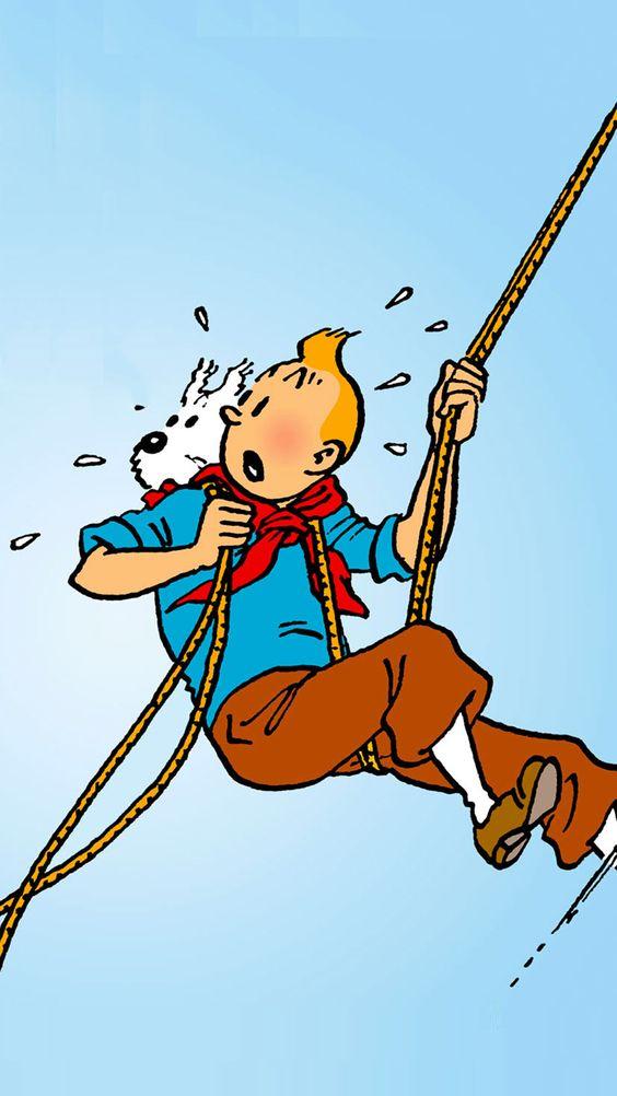 ロープを使って急な崖を進むタンタンの画像