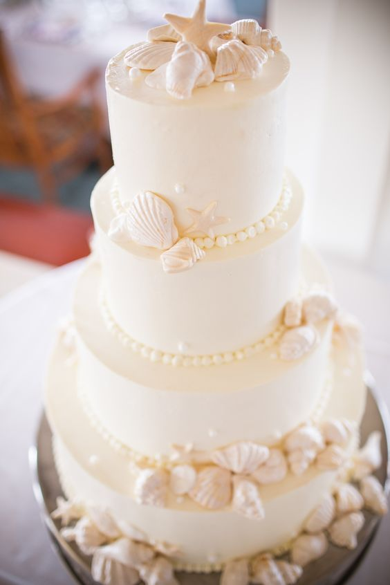 Seashell Wedding Cake Design | See the wedding here - on SMP: http://www.StyleMePretty.com/new-england-weddings/2014/03/05/whimsical-seaside-wedding/ Photography: Zev Fisher