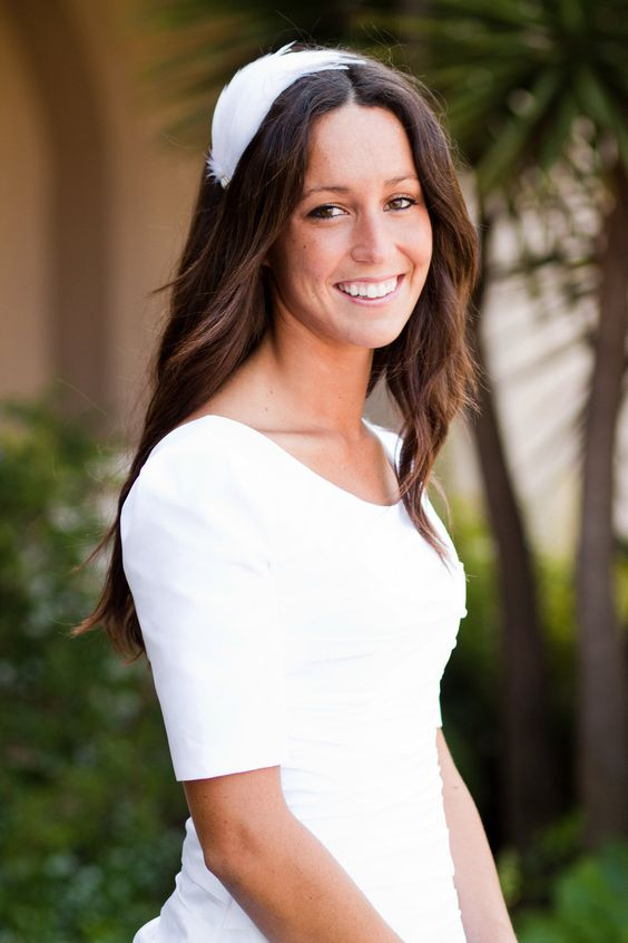 """Getting married? This feather headband is perfect for the bride who doesn't want a veil, but wants something different with a vintage flare. The pure white feather pad is made with rooster hackles that have a natural and vibrant shine. Feather pad measures 5"""" x 7.5"""" and features a vint...    $32"""