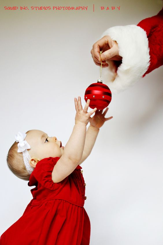 cute first Christmas photo ... dad as santa so as not to spook the little one : )
