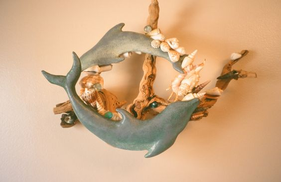 'Eternally, Dolphins' Clay, oils, wood and shells