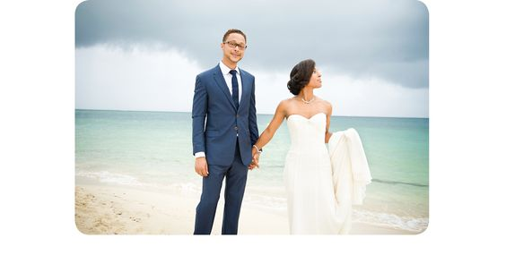 Joy and Yann's beautiful beach wedding at the dreamy club med in Martinique. The stormy sky and blue ocean created beautiful colour and light for this image.  ©RhapsodyRoadPhotography