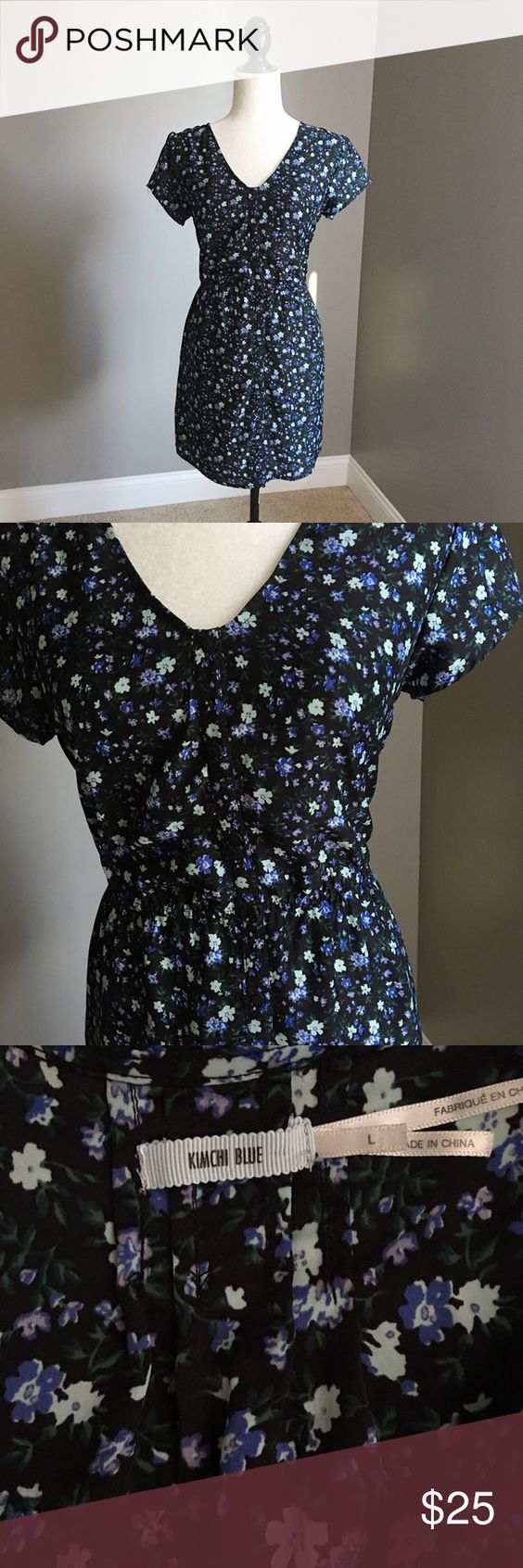 KIMCHI BLUE Black and Blue Floral dress Cute black with blue florals dress featuring working buttons all the way down, pockets, and an elastic at the waist. Excellent condition! Urban Outfitters Dresses