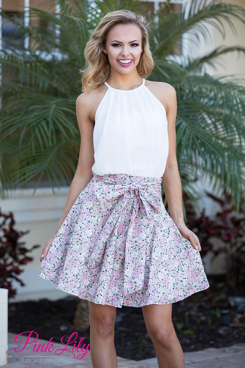 You'll look absolutely adorable in our Kiss 'n Tell skirt! Floral print skirt in shades of pink, green, navy, and off white with a tie around the waist!
