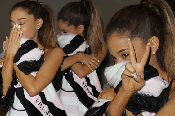 Ariana Grande covers her face with a Victoria's Secret blanket ...