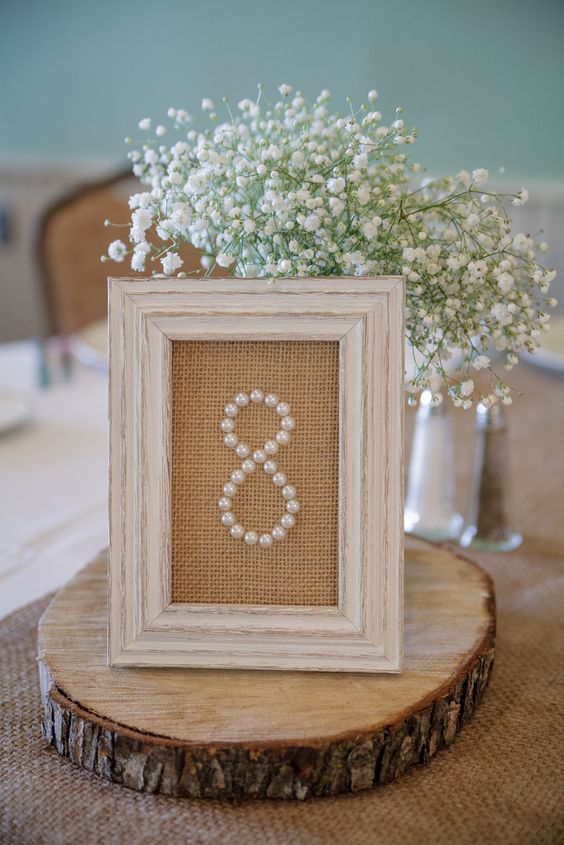 Pearl wedding table numbers in burlap backed frames | A DIY Wedding at The Landmark Resort in Egg Harbor, Wisconsin (Featured on The Knot) | Photo by Jason Mann Photography 920-246-8106 | www.JMannPhoto.com