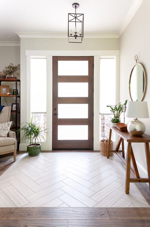 Ceramic tiles are used here to create an entry way 'zone' without walls.