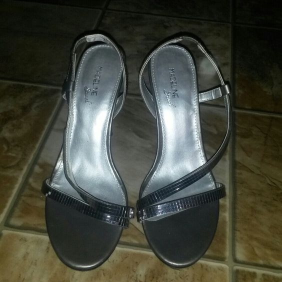 Shiny Sexy Silver Heels Worn Once Stilettos Bling Madeline Stuart heels size 8. They are silver and have small square shiny mirrored accents on the front straps. These shoes were very expensive & only worn once, in a wedding. I give great discounts (the more you buy, the more you save!!!) Madeline Stuart Shoes Heels