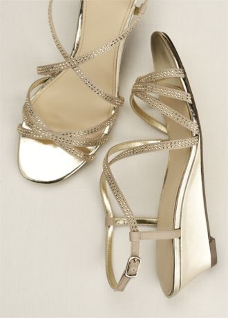 The super strappy wedge is the perfect sandal for every occasion! Satin wedge sandal features glistening embellishments across each strap. Heel Height - 1 3/4 inch. Imported.