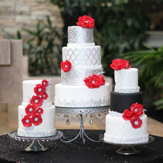 Ray and Artrese's glam wedding cake trio. Silver, red and perfect for their beautiful wedding today at The Eden Resort. Cake by The Couture Cakery
