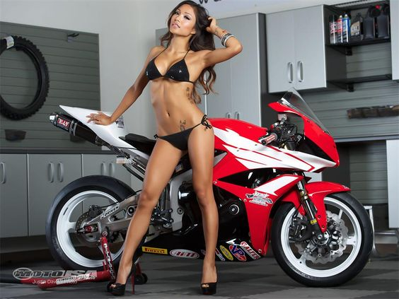 Motorcycle babe Janey with the 2012 Honda CBR600RR project bike, September 2012 pin-up calendar.