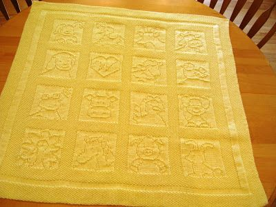 Down Cloverlaine baby blanket knitted from animal squares ...