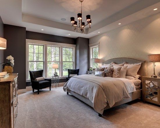 Master Bedroom With Tray Ceiling Recessed Lighting And Bay