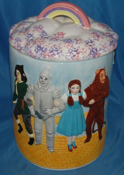Wizard of Oz cookie jar ~ I saw a Wizard of Oz tea pot years ago.  I really wanted it.  My daughter remembered, and got me the Wizard of Oz toy set at Mc Donalds.