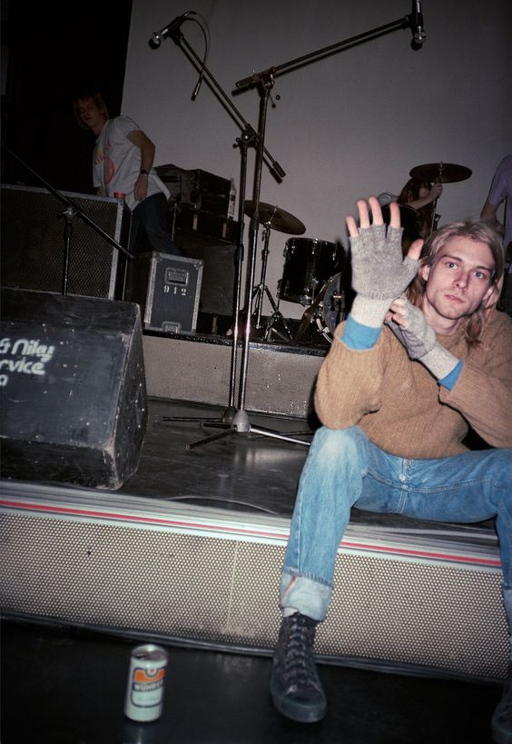Kurt Cobain greeting photographer Bruce Pavitt when he arrived at the Piper Club, Rome, 27 November 1989.