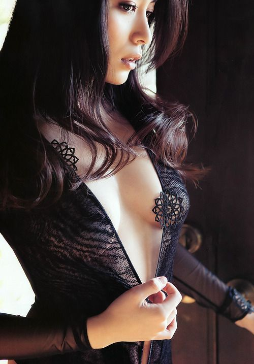 Gorgeous Asian in a revealing dress.