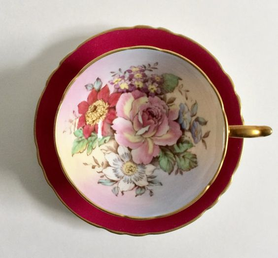 Vintage Paragon china tea cup and saucer, made in England. A lovely duo with gold gilding in burgundy with a beautiful bouquet in the bowl of the cup. It is in good condition, no chips, cracks or crazing. Please Note: The items I sell are not new, they are vintage or antiques, it goes without saying that there maybe some imperfections which I will try my best to point out and take pictures of.  I do not look at my items under a microscope, but I do the best I can to describe it.  Please ask q...