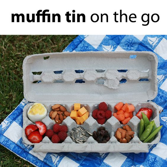Fill an egg carton with munchies and head to the park!  BRILLIANT.