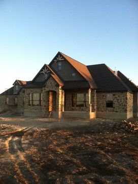 Stone and stucco texas hill country home with metal roof for Hill country stone