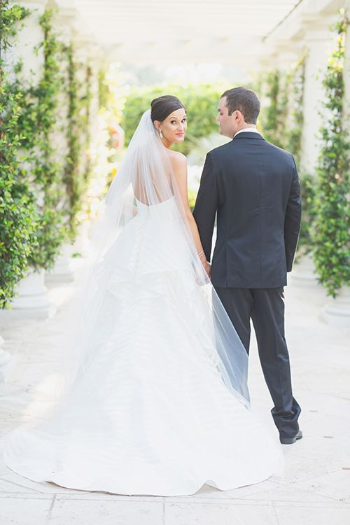A subtle candid shot of the bride and groom | @nickivitalic | Brides.com
