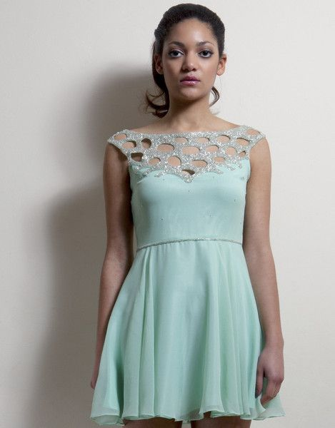 Mint green party dress featuring cut out silver beaded embellishing across shoulder.