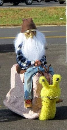 Coolest Homemade Gnome Riding a Snail Illusion Costume... This website is the Pinterest of costumes