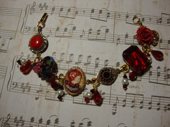 Vintage Bracelet Red .. made with Vintage Earrings and a Cameo, between each mounted earring are red glass beads and pearls ..   FOR SALE $45.00