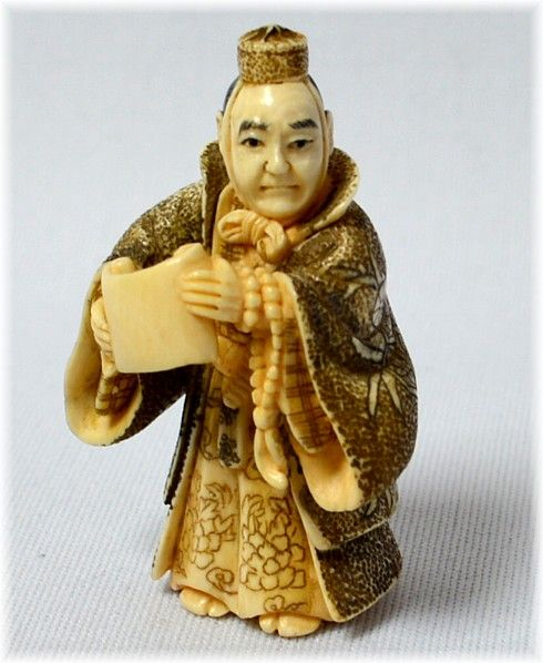 Benkei, the warrior monk with a scroll yamabushi sutras in the hands - Japanese netsuke ivory 1900-1920s.